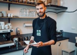 Barista with pastry dessert
