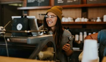 Restaurant or Coffee Shop with happy barista server with customers