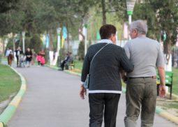 eldery customer walking with employee