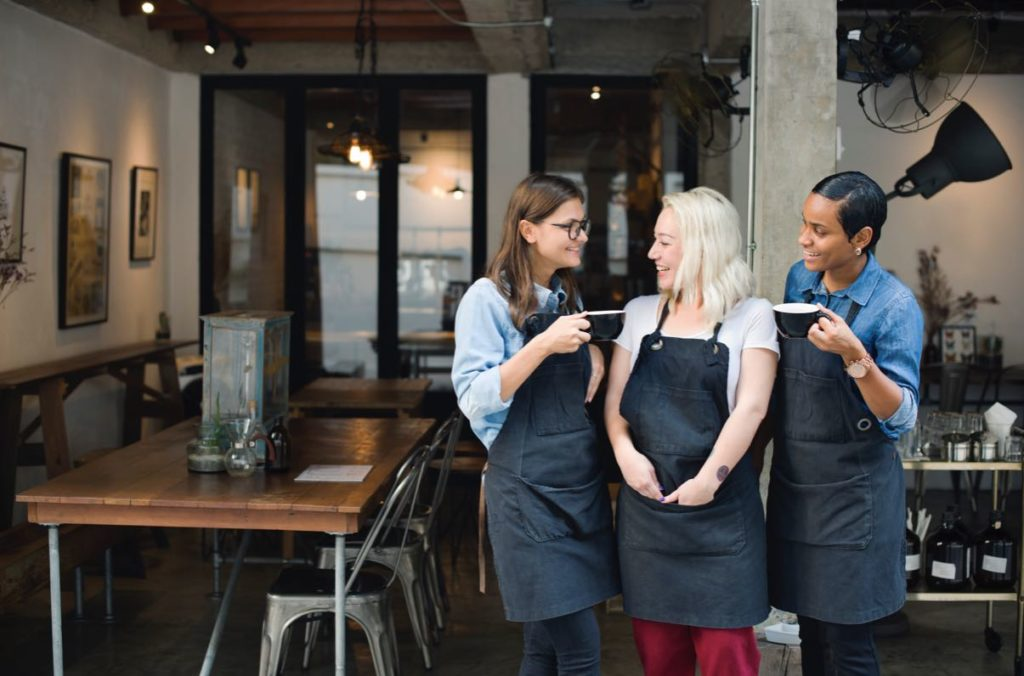 Happy servers, barista teamwork, coffee