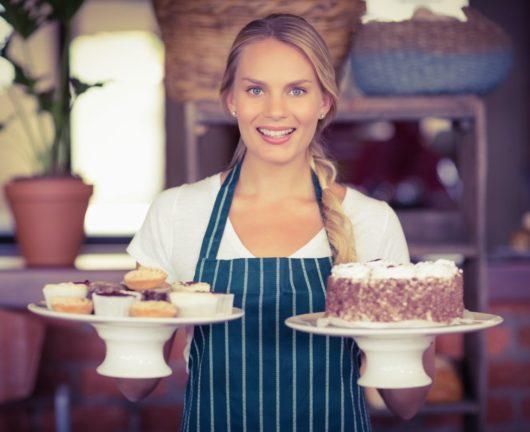 happy server with pastries