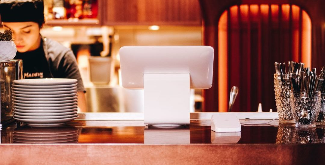 Restaurant or Coffee Shop with happy barista server with pastries, cake and customers
