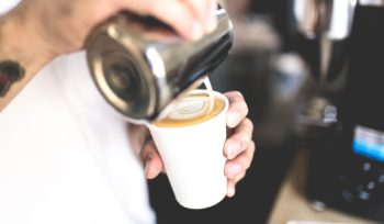 barista pouring latte art, cafe